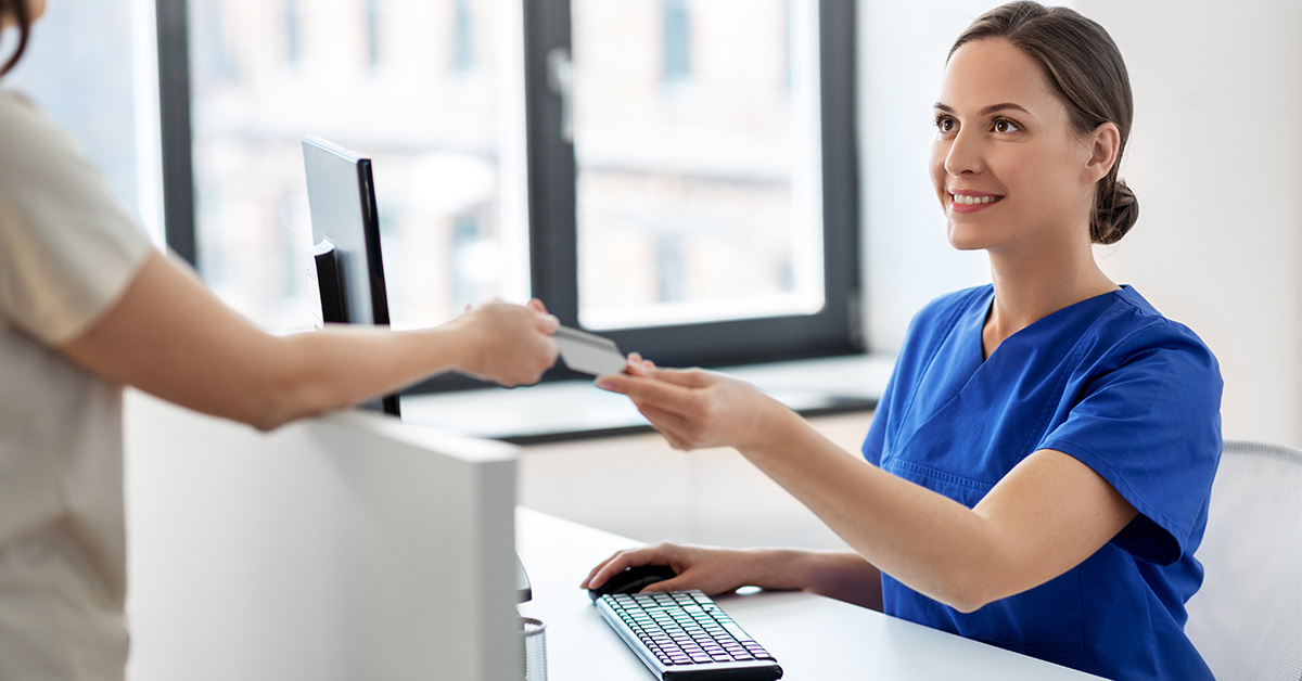 nurse collecting payment from patient
