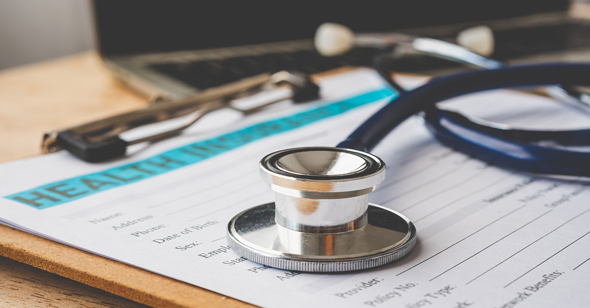 Insurance coverage form and stethoscope